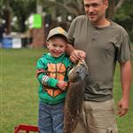 Son and Father holding a fish
