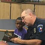 Mesquite Police Officer reads to student at MISD Elementary School Libraries_thumb.jpg