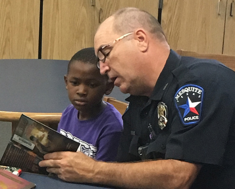 officer reads to child