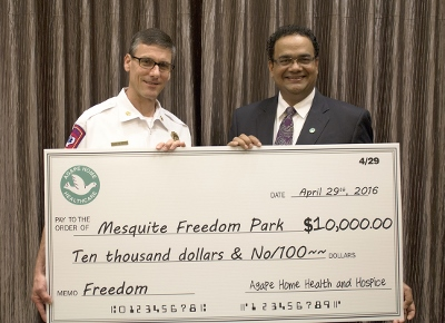 4-29-16 Mesquite Fire Chief Mark Kerby-Pres of Agape Home Health and Hospice Shaji K. Daniel (400x290).jpg