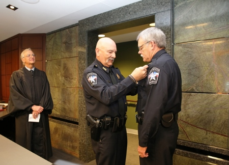 4-30-15 City Marshal Michael Meek pins badge on Deputy City Marshal (450x324).jpg