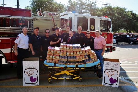 Mayor and Firefighters donating peanut butter and jelly